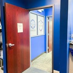Brown office door inside room with blue walls